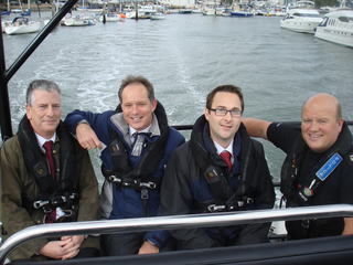 photo of Mike Thornton MP with Hampshire Constabulary Special Boat Team out on patrol along the River Hamble.